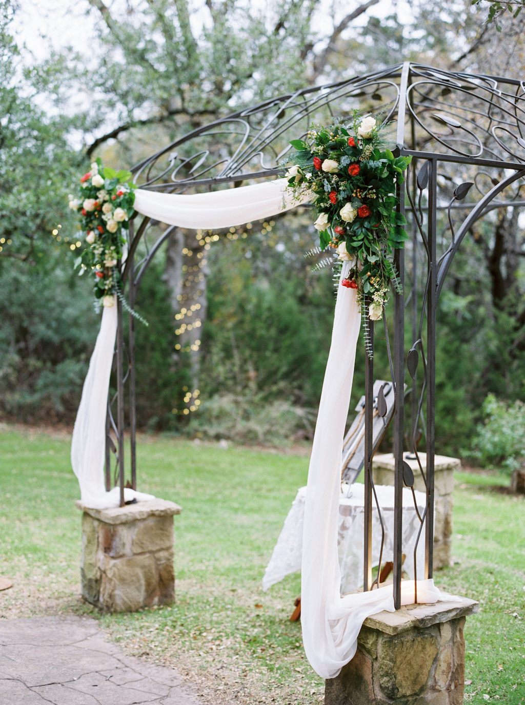 An elegant ceremony arbor is decorated for a winter wedding at a venue in Georgetown, Texas. Photo by Jen Dillender Photography.